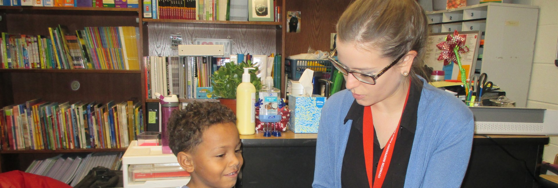 Ms. Mitchell and Emmanuel reading together